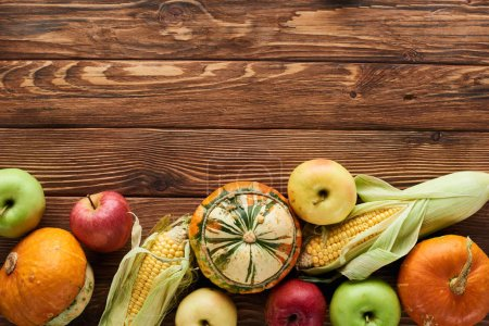 Photo for Top view of fresh apples, pumpkins and sweet corn on wooden surface with copy space - Royalty Free Image
