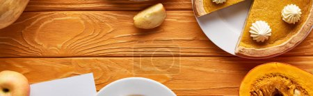 Photo for Top view of pumpkin pie, ripe apples on wooden table, panoramic shot - Royalty Free Image