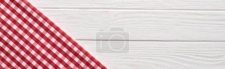 Photo for Top view of checkered red napkin at white wooden table, panoramic shot - Royalty Free Image