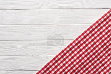 Photo for Top view of checkered red napkin at white wooden table - Royalty Free Image
