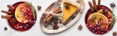 Photo for Panoramic shot of christmas cocktails with orange, pomegranate, cinnamon and pie on tray - Royalty Free Image