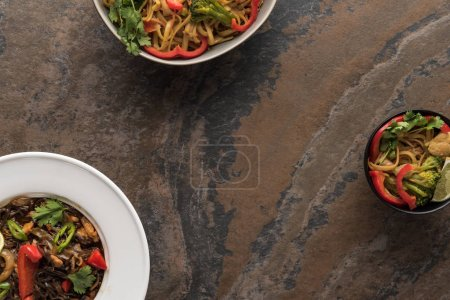 Photo for Top view of tasty spicy thai noodles on stone surface - Royalty Free Image