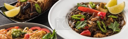 close up view of thai noodles on wooden grey surface, panoramic shot