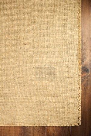 burlap hessian sacking backdrop on wooden background