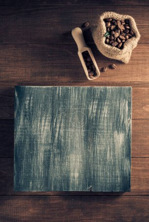 coffee beans in bag on wooden background