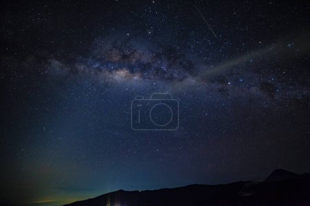 Photo for Milky way on dark night in Indonesia mountain range - Royalty Free Image