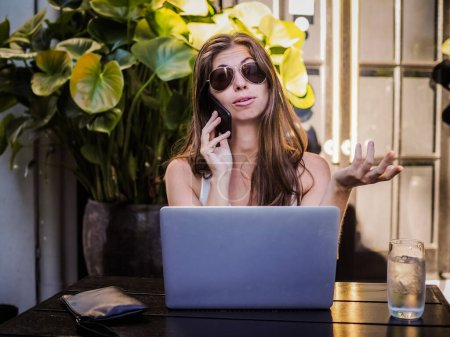 Photo for Beautiful young woman in a cafe with a laptop - Royalty Free Image