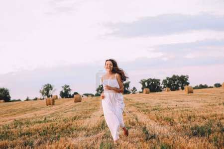 Photo for Autumn field golden happy girl activity movement joy straw plays - Royalty Free Image