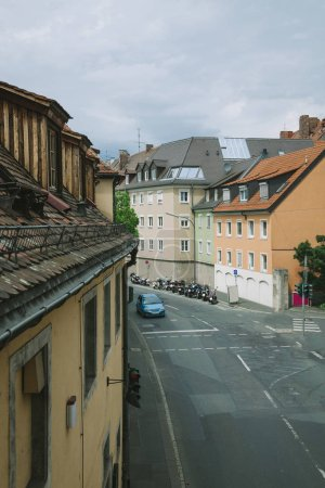 high angle view of car and scooters on street in Wurzburg, Germany