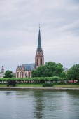 FRANKFURT, GERMANY - 28 JUNE 2018: beautiful Frankfurt Church of Three Kings near park and Main river