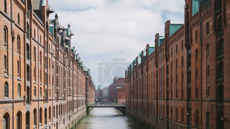 Photo for Elbe river, bridge and buildings at warehouse district in Hamburg, Germany - Royalty Free Image