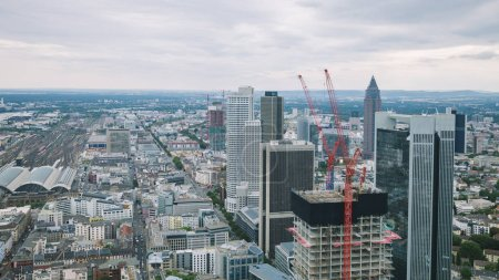 Photo for Aerial view of cityscape with skyscrapers and buildings near crane in Frankfurt, Germany - Royalty Free Image