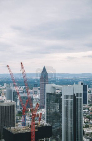 aerial view of crane, skyscrapers and buildings in Frankfurt, Germany