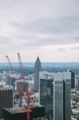aerial view of crane, skyscrapers and buildings in Frankfurt, Germany
