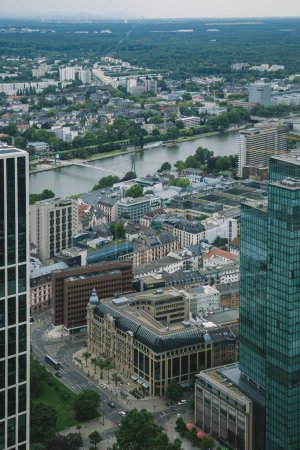 aerial view of cityscape with skyscrapers and buildings near Main river in Frankfurt, Germany