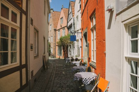 Photo for Street with summer restaurant and buildings during daytime in Bonn, Germany - Royalty Free Image