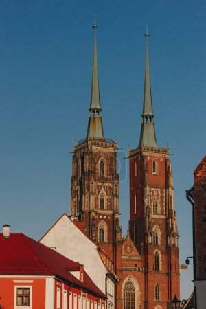 antique Cathedral of St John Baptist in front of blue sky, Wroclaw, Poland