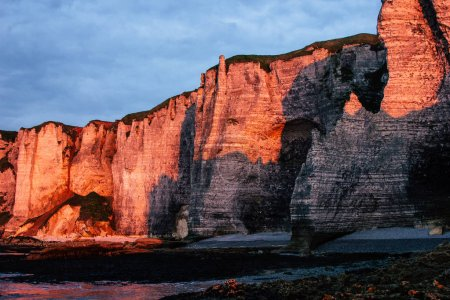 Photo for Scenic shot of rocky cliff on cloudy sunset, Etretat, France - Royalty Free Image