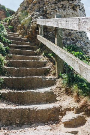 wooden railing and stone stairs on cliff, Etretat, Normandy, France