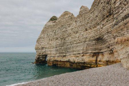 beautiful calm sea near cliff, Etretat, Normandy, France