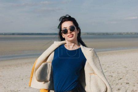 beautiful girl in sunglasses posing on beach, saint michaels mount, France