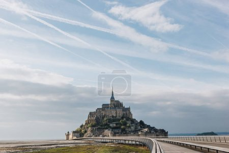 beautiful view of famous mont saint michel and walkway, normandy, france