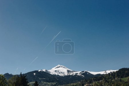 majestic snow-covered mountain peak and clear blue sky, mont blanc, alps