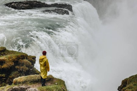 Photo for Aerial view of man standing Gullfoss waterfall with steam in Iceland - Royalty Free Image