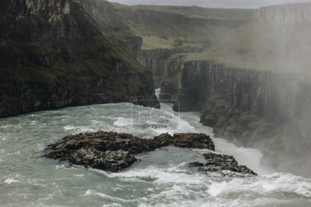 high angle view of steam above Gullfoss waterfall in Iceland
