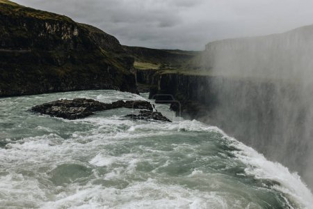 scenic view of steam above beautiful Gullfoss waterfall in Iceland