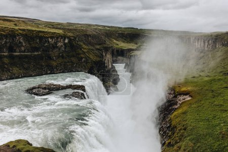 Photo for Scenic view of steam above beautiful Gullfoss waterfall  flowing through highlands in Iceland - Royalty Free Image