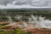 """Постер, картина, фотообои """"Аэрофотоснимок пейзаж с вулканического жерла под пасмурным небом в Долина Хёйкадалур в Исландии"""""""