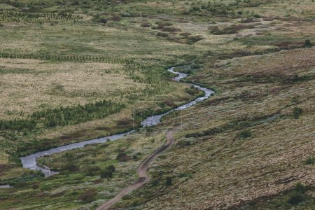 Photo for Aerial view of beautiful river flowing through highlands in Iceland - Royalty Free Image