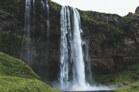 scenic view of beautiful Seljalandsfoss waterfall in highlands in Iceland