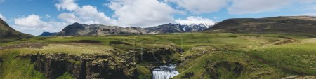 panoramic view of landscape with beautiful Skoga river flowing through highlands in Iceland