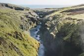 """Постер, картина, фотообои """"Аэрофотоснимок красивой реки Скоуг, протекающей через высокогорье в Исландии"""""""