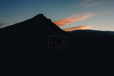 Photo for Scenic view of mountain in dusk and dramatic sky during sunset in Iceland - Royalty Free Image