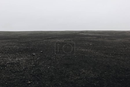 Photo for Full frame image of black sand beach against cloudy sky in Solheimasandur, Iceland - Royalty Free Image