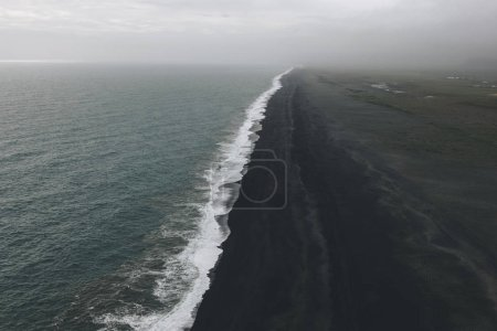 Photo for Aerial view of coastline with black sand beach near wavy ocean in Vik, Iceland - Royalty Free Image