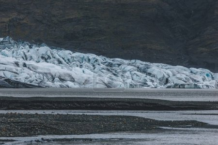 glacier Skaftafellsjkull and snowy coastline during daytime in Iceland