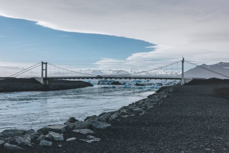 Photo for Modern bridge crossing blue river with glacier water in Jokulsarlon, Iceland - Royalty Free Image