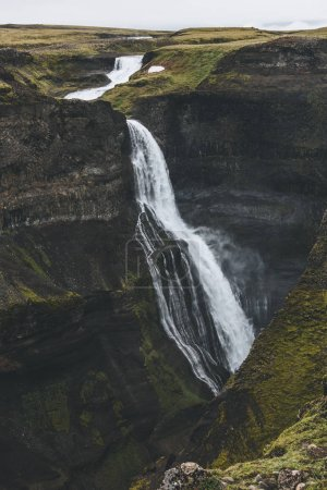 aerial view of scenic Haifoss waterfall and rocky cliff, Iceland