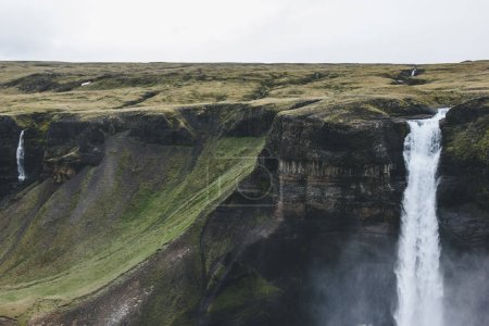 Photo for Aerial view of dramatic Haifoss waterfall and rocky cliff, Iceland - Royalty Free Image