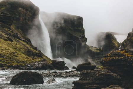 beautiful icelandic landscape with Haifoss waterfall on misty day