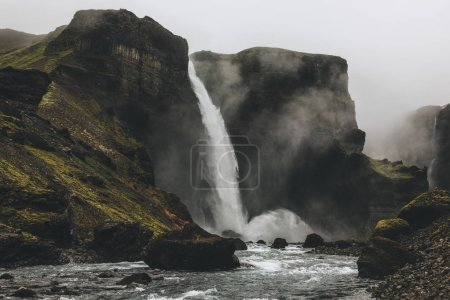 scenic shot of Haifoss waterfall with mist around, Iceland