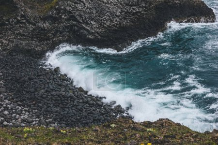 Photo for Aerial view of waves crashing on rocky coast in Arnarstapi, Iceland - Royalty Free Image