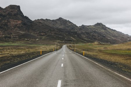 Photo for Empty asphalt road in Iceland with beautiful mountains on background - Royalty Free Image