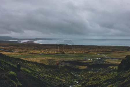 Photo for ICELAND - 22 JUNE 2018: scenic with of icelandic coast and green valley with crowd of tourists - Royalty Free Image