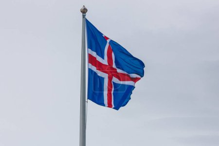 close-up shot of iceland flag in front of cloudy sky