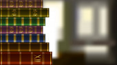 Stack of old expensive books on blurred background